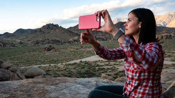 a-young-lady-taking-selfie-near-mountains