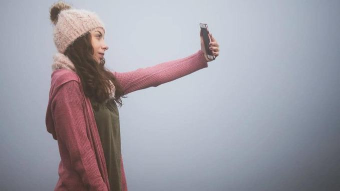a-young-lady-taking-selfie