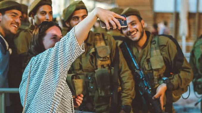 girl-taking-selfie-with-army-people