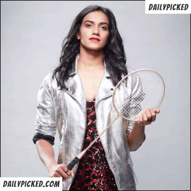 pv sindhu holding badminton shuttle