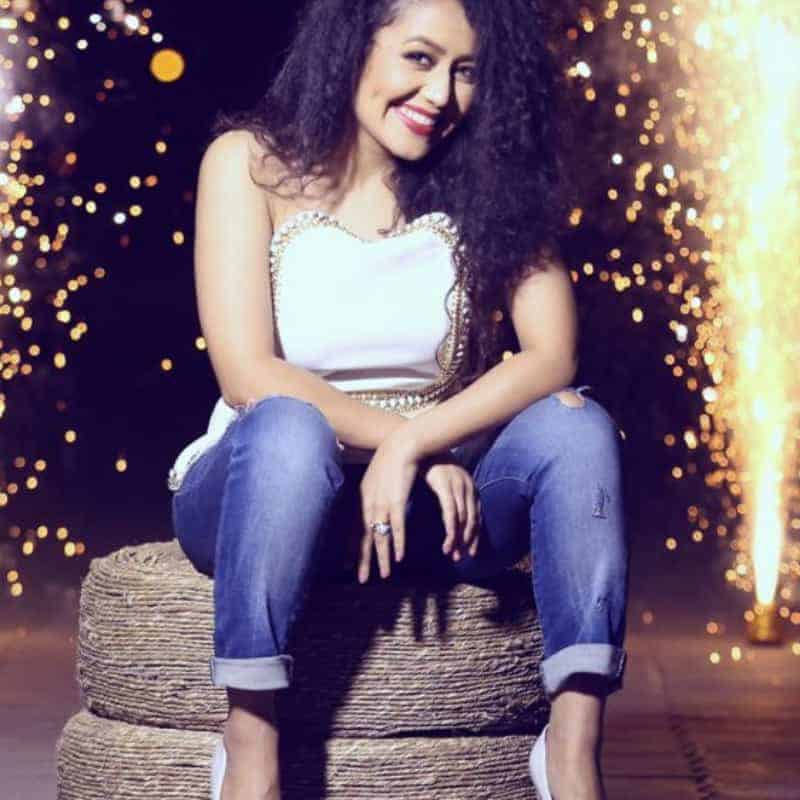 Neha Kakkar in white top and blue jeans